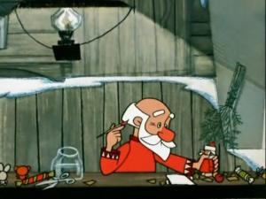 Дед Мороз берет уже раскрашенного Дед-мороза